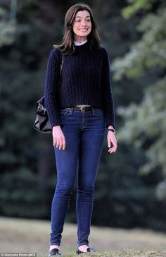Cheesy grin: Actress Anne Hathaway looked to be having a blast on set on Thursday for upcoming comedy The Intern
