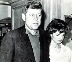 Jack and Jackie leaving his father's hospital room after Joe Kennedy suffered a stroke in Palm Beach. Both clearly distraught.