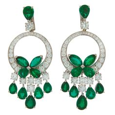 GRAFF Emerald Diamond White Gold Earrings | From a unique collection of vintage dangle earrings at https://www.1stdibs.com/jewelry/earrings/dangle-earrings/