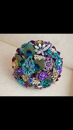 Custom bouquet that inspired me to make my own brooch bouquet. I want to include bling, feathers, and flowers. Bouquet by: It's All Coming Up Popes and Posies