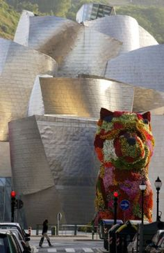 Jeff Koons Puppy at the Guggenheim Bilbao. @Fritillaria When we have our adjoining mansions, I must warn you that I will need a giant flower pug topiary