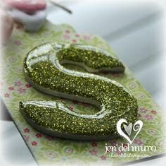 This Glazed Glitter technique You'll need:  Chipboard or thick cardstock die cut Diamond Glaze/Crystal Effects Fine glitter Adhesive to apply glitter #glitter #crafts