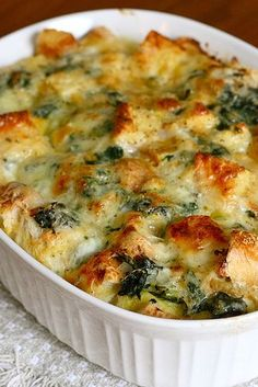 {Spinach Cheese Strata} ---- My husband spit out his 2nd bite, my neighbor gobbled up half the pan and I was somewhere in the middle. Flavor wise - loved it. Texture wise --- eh, not so much...TOOO SOFT/MUSHY. I was expecting it to have the firmness of stuffing...maybe I didn't cook it long enough, maybe if I used stale bread instead of fresh ... maybe that is what strata is sup to feel like (I've never had it before). Note...The Gruyere is quite $$$.
