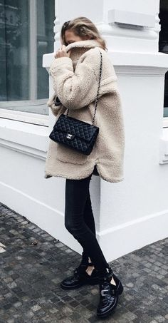 Cozy winter white jacket with all black.