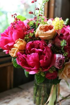 Peonies, single flower; multi color arrangement.