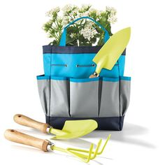 Tools of the trade! This colorful canvas bag comes stocked with everything you need to sow those seeds. Hold all your tools and gardening needs here for a one-trip down to the garden. Also, doubles as a handy farmer's market bag. Includes 3 gardening tools with the bag, a rake, trowel, and planter.FEATURES• Blue tote bag with dark blue trim• Tools are yellow with a wooden handle• Double handles• Pockets are in the front and back of the piece•...