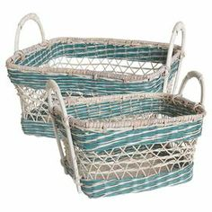 "In breezy blue and white, these woven rattan baskets stow towels in your master bath or magazines in the living room with charming style.   Product: Small and large basketConstruction Material: Wicker and rattanColor: Blue and whiteDimensions: 11"" H x 19"" W x 16"" D (large)"