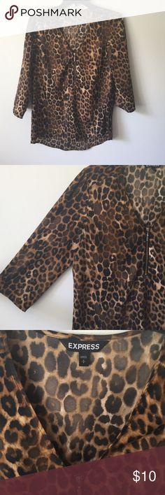 Cheetah Print Blouse Express cheetah print shirt with a v neck zipper and mid length sleeves Express Tops Blouses