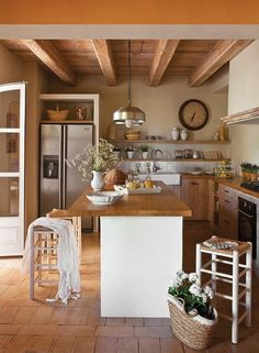 **1**Country kitchen.Detail: fridge in a box, makes space for storage on top of it. A simple life. Habacuc 2.2