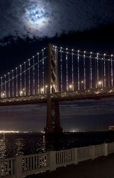 """""""Bay Lights"""": San Francisco's Bay Bridge is now the world's largest light sculpture, with 25,000 LED lights programmed to create unique sparkling patterns--never repeating a pattern in it's scheduled 2 year lifespan.  The project went live March 5, 2013. 