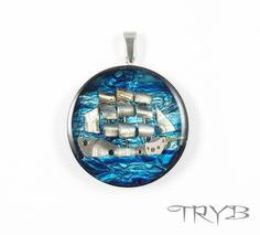 The Sailing Ship pendant in stainless steel. 100% handmade and clockwork.