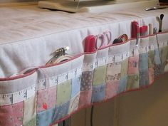 Sewing Machine Mat with Pockets--Could do this for my table skirts