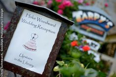 A playful sign directs guests to the reception. Wedding Ceremony and Reception Venue: Tarpy's Roadhouse and Monterey Stone Chapel Wedding Photographer: Chris Schmauch, Goodeye Photography+Design