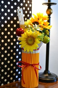 Decoration ideas for a Back to School Bash {Made by a Princess Parties in Style} -- Honestly, this little pencil bouquet caught my eye.  Very cute and crafty!  Might have to make one someday for a future teacher of one of our future children!