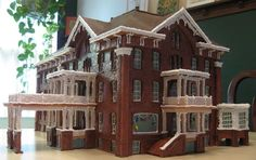 This house is a re-creation of a riverside hotel that was torn down in the 1950s to make room for a gas station. To get all the detail, this artist used a band saw, a Dremel tool, and an X-Acto knife. | Created by Rebecca W. of Potsdam, NY.