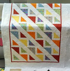 Cute quilt!  Large HSTs and smaller HSTs  with background fabric to make block same size as the Large HST