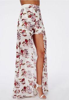 Work this chic maxi skirt with fanciful floral print covering. With floaty under shorts complete with chiffon maxi over skirt split to the front this skirt is a total dream. Team with white bodysuit and strappy heels for that luxe finish.  ...