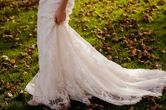 Lace Bridal train - Image by Katherine Ashdown - Blue By Enzoani Gown And Allure By Jimmy Choo Shoes For A Rustic Autumn Wedding At Leez Priory Essex With Bridesmaids In Pale Pink Ghost Dresses And Images From Katherine Ashdown