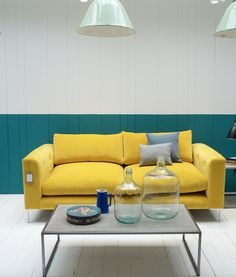 Loaf's colour pop Rockstar sofa in bright Bumblebee yellow velvet at their Notting Hill Loaf Shack