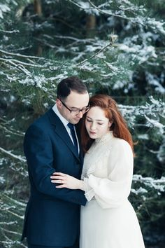As the snow fell, it got me thinking about how much I'd love to shoot a snowy winter wedding, and how much of a shame it was that we'd not be able to find anybody to model in this snow for us before it all melted away the next day.  And then it hit me - why don't we just raid our own wardrobe, go out there in the morning and take some wedding pictures ourselves.. self-portrait style!