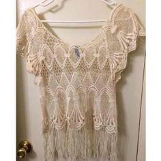 Crochet Top W/ Fringe Detail NWOT Perfect condition ! No stains or snags ! Perfect to wear as a bikini top cover up..It's ONE SIZE fits all. So it's more of a large. It's 65% cotton 35% polyester- Tops Blouses