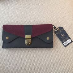 Jack Wills unused wallet Unused, tags attached wallet. Beautiful navy leather with a burgundy flap. Weathered gold accents. Card slots, coin purse, and 2 pockets for cash. Jack Wills Accessories