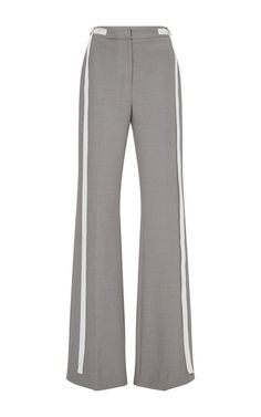 These **ADEAM** trousers feature a flared leg and a mid rise waist.