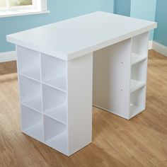This counter-height craft table allows you to stand and work, and ample shelf space means you can store all your crafting items with ease. The sleek design of this storage craft table allows it to fit