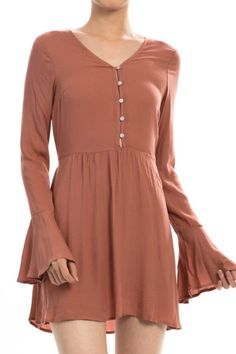 Channel your inner free-spirit in this romantic blush babydoll dress with bell sleeves. Add your favorite leggings and fringe booties to complete your classic boho look! Details Fabric: 100% rayon Mea