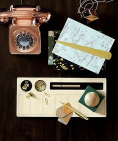 the past is calling. We're bringing the land line back with this iconic British telephone circa 1967. We kept the authentic vintage silhouette, but added a few 2016 upgrades. The dial has been replaced with push buttons. A redial button is a new add as well. Not to mention the gorgeous metallic copper finish. Push button phone lugs into the standard land line socket. Makes a fun housewarming gift.