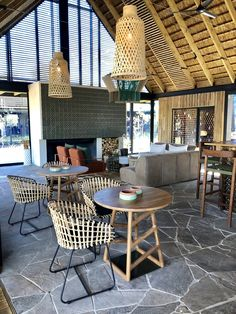 Designed for Megan Ralph Spaces for a safari lodge, these beautiful green ceramic wall tiles add a touch of African elegance to the thatched guest area complimenting the rest of the interior design.  #ceramic #wallpaper #design #interiordesign #architecture #southafrican #guesthouse #safari #decor #fireplace #tiles #wall #walltiles #featurewall #designideas #designinspo #homerenovations #hotel #renovations