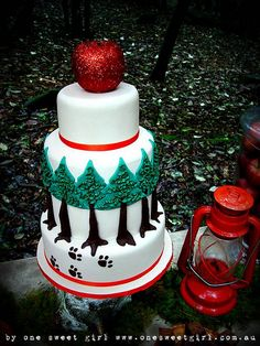 Four tier cake for a little red riding hood dessert table