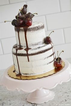 Semi-naked vanilla buttercream,  dark chocolate cake brushed with orange liqueur and filled with cherry preserves with ganache and topped with cherries and chocolate almond cherry bark from Curly girl kitchen ~ we ❤ this! moncheribridals.com