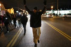 Stores and police vehicles burned, dozens of people were arrested, and protesters clashed with police after officials Tuesday Morning, Monday Night, Ferguson Protest, Ferguson Missouri, Darren Wilson, Grand Jury, Michael Brown, Police Vehicles, Powerful Images