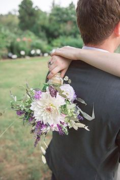 purple and white wedding bouquet http://www.weddingchicks.com/2013/10/14/tea-party-wedding-ideas/