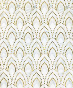 Nadja / Atelier Collection featured in natural stone (Calacatta Oro) & Brass by Mosaique Surface
