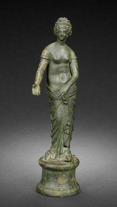 A Roman bronze figure of Aphrodite. Circa 1st-2nd Century A.D.