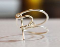 "initial ""P"" wire wrapped ring"