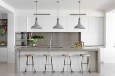 Light, bright, minimal kitchen with a slight industrial feel.  By Justine Hugh Jones