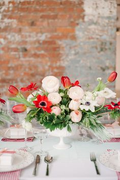 #ranunculus, #anemone, #centerpiece, #tulip  Photography: Brklyn View Photography - www.brklynview.com  Read More: http://www.stylemepretty.com/2014/06/12/bridal-shower-inspiration-with-a-fresh-pop-of-color/