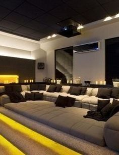 Browse home theater design and living room theater decor inspiration. Discover d… Browse home theater design and living room theater decor inspiration. Discover designs, colors and furniture layouts for your own in-home movie theater. Home Theater Room Design, Home Cinema Room, Home Theater Decor, Best Home Theater, At Home Movie Theater, Home Theater Rooms, Home Theater Seating, Attic Theater, Home Theatre