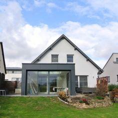 Agrandissement de maison en ossature bois avec toit plat for Agrandissement maison 93