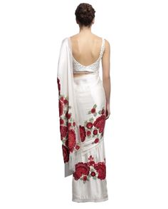 This designer saree is in ivory colour with hand embroidered flowers in red and maroon shades. Blouse of this saree is also in ivory colour with hand embroidery on it. This designer saree comes with a matching petticoat. Red And White Saree, White Saree Blouse, Designer Sarees Online, Designer Dresses, Floral Embroidery, Embroidered Flowers, Hand Embroidery, Online Saree Purchase, Floral Print Sarees
