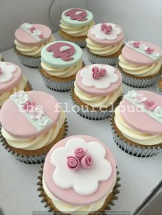 Pretty pink elephant and flowers birthday cupcakes.