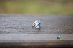 One of a kind, fine silver swirl ring, with blue opal. Size 8. Jewelry making, metalsmith, Nature by Design Photography