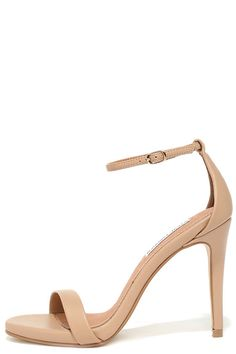 Either with your beau or on your own, wherever you go the Steve Madden Stecy Natural Ankle Strap Heels will step up your style! These chic high heel sandals are made from matte nude faux leather, with an on-trend single toe band and an adjustable ankle strap (with gold buckle) anchored by a slender heel cup.