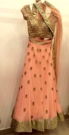Looking for peach lehenga with delicate gold work? Browse of latest bridal photos, lehenga & jewelry designs, decor ideas, etc. on WedMeGood Gallery. Lehenga Saree, Bridal Lehenga, Gold Lehenga, Anarkali Suits, Punjabi Suits, Sari, Indian Attire, Indian Wear, Indian Dresses