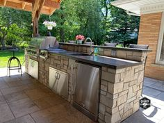 The Quarry Mill's Stonegate real thin stone veneer creates a stunning outdoor kitchen and bar under this beautiful covered patio. #naturalstoneveneer #realstoneveneer #thinstoneveneer #outdoorkitchen #outdoorliving #barandgrill #quarrymill #quarry #masonry #dreamhome #newhome #welcomehome #coveredpatio #stonesiding #stainlesssteel Real Stone Veneer, Natural Stone Veneer, Natural Stones, Ashlar Pattern, Outdoor Bbq Kitchen, Stone Siding, Porch Columns, Exterior Siding, Outdoor Living