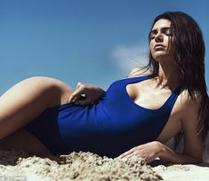 Posing up a storm: Kendall put on a sultry display in her scanty swimsuit as she grazed her hand across her thigh and pouted down the lens