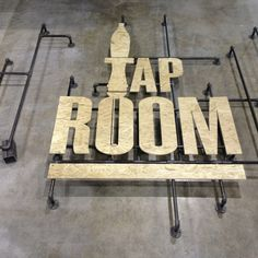 Tap Room Logo, I like that the sign is elevated with the piping.